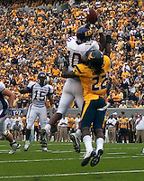 East Carolina wide receiver Jamar Bryant (10) makes a catch. The WVU Mountaineers defeated the East Carolina Pirates 35-20 at Mountaineer Field at Milan Puskar Stadium, Morgantown, West Virginia on September 12, 2009.