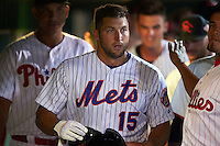 Scottsdale Scorpions left fielder Tim Tebow (15), of the New York Mets organization, in the dugout during a game against the Salt River Rafters on October 12, 2016 at Scottsdale Stadium in Scottsdale, Arizona.  Salt River defeated Scottsdale 6-4.  (Mike Janes/Four Seam Images)