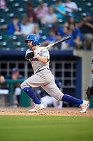 Midland RockHounds second baseman J.P. Sportman (25) follows through on a swing during a game against the Northwest Arkansas Naturals on May 27, 2017 at Arvest Ballpark in Springdale, Arkansas.  NW Arkansas defeated Midland 3-2.  (Mike Janes/Four Seam Images)