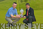Seamus ONeill, Castleisland Golf Mens captain, presents Denny Lyons with the Captains Prize on the 18th Green.