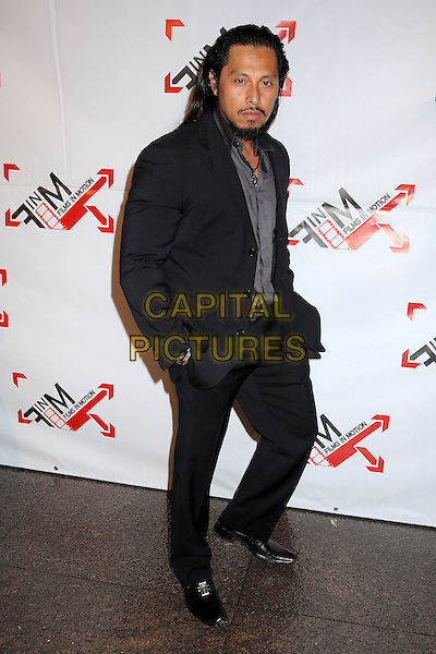 "SAM MEDINA .""Blood Out"" Los Angeles Premiere held at the DGA, West Hollywood, California, USA, 25th April 2011..full length hands in pockets suit  beard facial hair goatee black grey gray shirt .CAP/ADM/BP.©Byron Purvis/AdMedia/Capital Pictures."