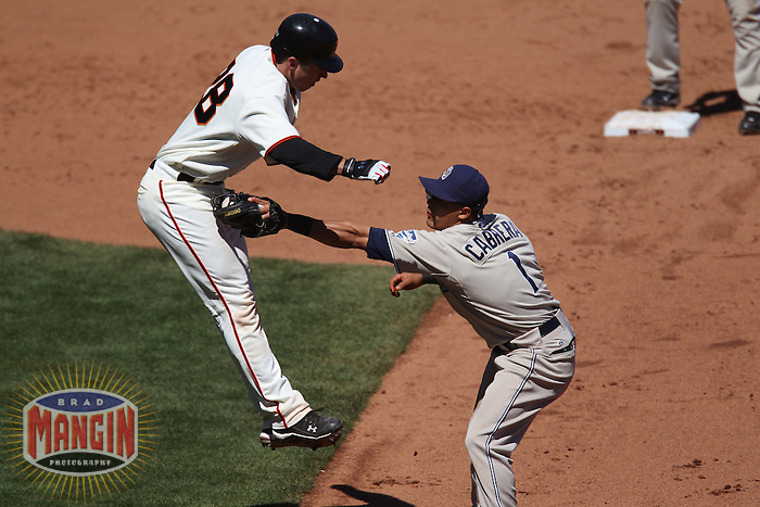 SAN FRANCISCO - AUGUST 15:  Buster Posey of the San Francisco Giants is tagged out on the base paths by San Diego Padres second baseman Everth Cabrera during the game at AT&T Park on August 15, 2010 in San Francisco, California. Photo by Brad Mangin