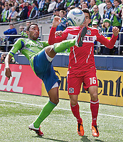 Seattle Sounders FC defender James Riley battles Chicago Fire midfielder Marco Pappa during play between at Qwest Field in Seattle Tuesday April 8, 2011. The Sounders won the game 2-1.