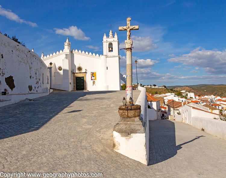 Historic whitewashed church Igreja Matrix in medieval village of Mértola, Baixo Alentejo, Portugal, Southern Europe