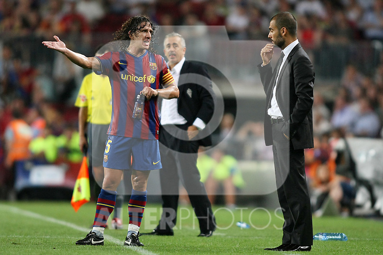 FC Barcelona's Carles Puyol (l) and Pep Guardiola during  La Liga match.August 31 2009. (ALTERPHOTOS/Acero).
