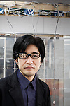 Tokyo, January 17 2013 - Portrait of Japanese researcher and designer Jun Rekimoto at his lab in Tokyo University, wearing an early version of Aided Eyes glasses.