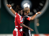Maicon Santos (29) of D.C. United goes up for a header with Ugo Ihemelu (3) of FC Dallas at RFK Stadium in Washington DC.   Dallas FC fell to D.C. United, 4-1.