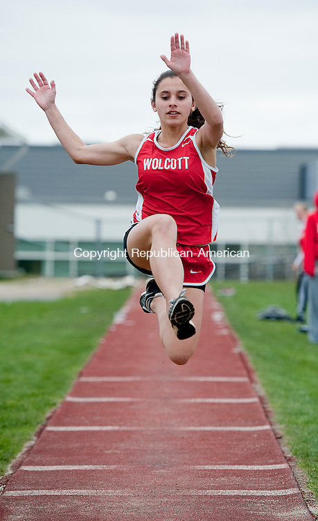 WATERTOWN, CT-0429014JS1--Wolcott's Christina Valez competes in the long jump during their track meet against Woodland and Watertown Tuesday at Watertown High School.<br /> Jim Shannon Republican-American