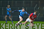 Sigerson Cup team's Maurice Fitzgerald gets away from IT Tralee's Joe Scully at Austin Stack park, Tralee on Friday.