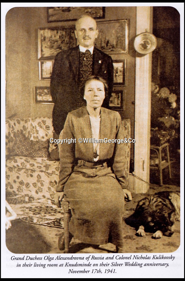BNPS.co.uk (01202 558833)<br /> Pic: WilliamGeorge&Co/BNPS<br /> <br /> Grand Duchess Olga Alexandrovna of Russia and Colonel Nicholas Kulikovsky in their living room at Knudsminde November 17, 1941.<br /> <br /> A remarkable series of letters from one of the surviving Romanovs have been unearthed which reveal her 'hate' towards the Allies in the aftermath of the Russian Revolution.<br /> <br /> The Grand Duchess Olga Alexandrovna - the younger sister of Tsar Nicholas II - penned more than 50 letters to her sister Xenia between 1916 and 1920 which provide a fascinating insight into the perilous existence of the Romanovs, the last Russian royal family.<br /> <br /> The letters were written mostly in English to get past the censors since the Romanovs lived in constant fear of assassination by Bolshevik forces.