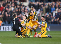 17th March 2019, The Den, London, England; The Emirates FA Cup, quarter final, Millwall versus Brighton and Hove Albion; Lewis Dunk of Brighton & Hove Albion, Shane Duffy of Brighton & Hove Albion, Solly March of Brighton & Hove Albion, Davy Propper of Brighton & Hove Albion, Jose Izquierdo of Brighton & Hove Albion Brighton and Hove Albion celebrate after Goalkeeper Matthew Ryan of Brighton & Hove Albion saves a penalty during the Penalty shoot out to book Brighton and Hove Albion into the FA Cup Semi Final