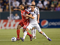 Toronto FC forward Dwayne De Rosraio (14) battles LA Galaxy midfielder Todd Dunivant (2). The LA Galaxy and Toronto FC played to a 0-0 draw at Home Depot Center stadium in Carson, California on Saturday May 15, 2010.  .