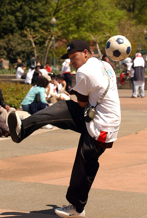 Rodrigo Martines, of New York City, plays soccer in Upper Senate Park, after lobbying Hill offices with about 500 other Mexican immigrants.  Their group, The Tepeyac Association, promotes the social welfare and human rights of Latino immigrants, specifically the undocumented Mexicans, in New York City.