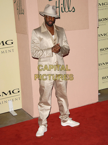 WYCLEF JEAN.attends The Sony / BMG Post Grammy Party held at The Beverly Hills Hotel in Beverly Hills, California, USA, February 11 2007..full length gold cream suit trainers hat.CAP/DVS.©Debbie VanStory/Capital Pictures
