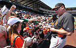 Giants Manager Bruce Bochy and infielder Pablo Sandoval, rear, sign autographs before a Cactus League preseason game between the San Francisco Giants and the Arizona Diamondbacks in Scottsdale, Ariz., on Sunday, March 4, 2012. .Photo by Cathleen Allison