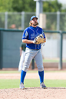 Team Italy relief pitcher Valerio Simone (14) gets ready to deliver a pitch during an exhibition game against the Oakland Athletics at Lew Wolff Training Complex on October 3, 2018 in Mesa, Arizona. (Zachary Lucy/Four Seam Images)
