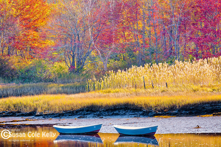 Fall foliage and rowboats on the Mousam River in Kennebunk, ME, USA