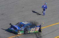 Apr 26, 2009; Talladega, AL, USA; NASCAR Sprint Cup Series driver Carl Edwards runs to the finish line after flipping over on the last lap during the Aarons 499 at Talladega Superspeedway. Mandatory Credit: Mark J. Rebilas-