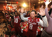NWA Democrat-Gazette/ANDY SHUPE<br /> Team captains quarterback Austin Allen (from right) and Kevin Richardson II, Arkansas defensive back, call the Hogs Friday, Aug. 18, 2017, alongside a room full of fans during the Kickoff Luncheon at the Northwest Arkansas Convention Center in Springdale. Visit nwadg.com/photos to see more photographs from the luncheon.