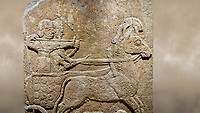 Photo of Hittite relief sculpted orthostat stone panel of Long Wall Limestone, Karkamıs, (Kargamıs), Carchemish (Karkemish), 900 - 700 B.C. Anatolian Civilisations Museum, Ankara, Turkey.<br /> <br /> Chariot. One of the two figures in the chariot holds the horse's headstall while the other throws arrows. There is a naked enemy with an arrow in his hip lying face down under the horse's feet It is thought that this figure is depicted smaller than the other figures since it is an enemy soldier. The lower part of the orthostat is decorated with braiding motifs. <br /> <br /> On a brown art background.