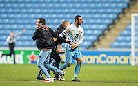Marcus Tudgay of Coventry City is passed by Coventry City supporters run onto the pitch to celebrate there team reaching the Wembley Final after of the The Checkatrade Trophy - EFL Trophy Semi Final match between Coventry City and Wycombe Wanderers at the Ricoh Arena, Coventry, England on 7 February 2017. Photo by Andy Rowland.