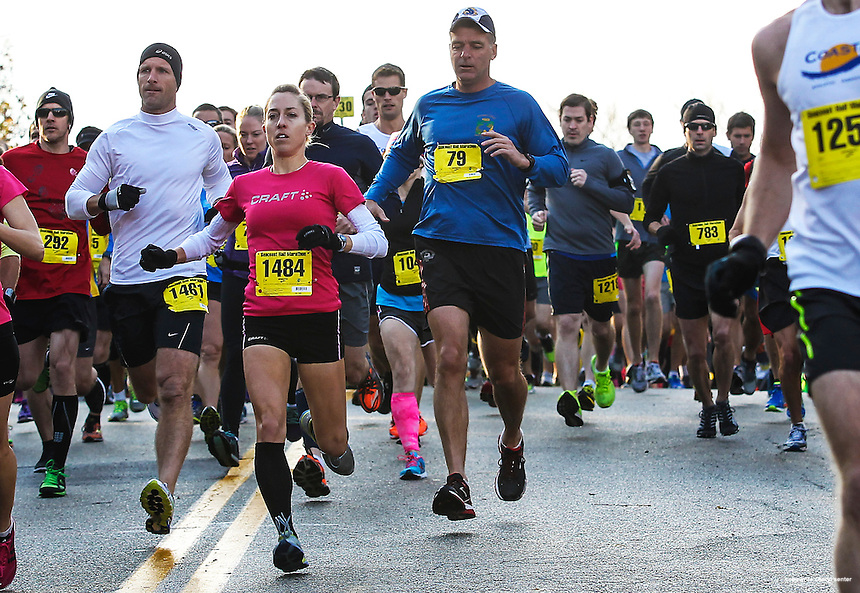 Heading out at start of race, Meagan Nedlo of Salem, MA, #1484, third from left, comes in first in the women's division of the annual Seacoast Half Marathon in Portsmouth, N.H., Sunday, Nov. 10, 2013.  (Portsmouth Herald Photo Cheryl Senter)
