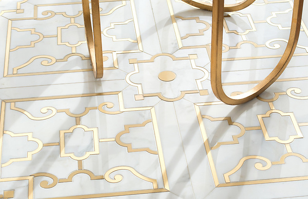 Jardin de Versailles, a waterjet stone mosaic, shown in polished Calacatta Gold and Brass, is part of the Jardins Français collection by Caroline Beaupere for New Ravenna.