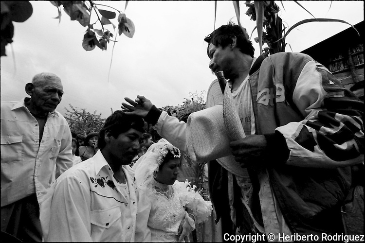 A Zapotec Native newly-married couple arrives at their home during their wedding ceremony in Coatecas Altas village, Oaxaca, November 22, 1998. Most of the villagers of Coatecas leave their home to harvest in northern state of Sinaloa.  © Photo by Heriberto Rodriguez