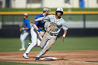 Eric Brown (20) of the Coastal Carolina Chanticleers rounds third base during the game against the Duke Blue Devils at Segra Stadium on November 2, 2019 in Fayetteville, North Carolina. (Brian Westerholt/Four Seam Images)