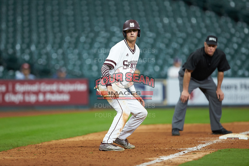 Tanner Poole (12) of the Mississippi State Bulldogs takes his lead off of third base against the Houston Cougars in game six of the 2018 Shriners Hospitals for Children College Classic at Minute Maid Park on March 3, 2018 in Houston, Texas. The Bulldogs defeated the Cougars 3-2 in 12 innings. (Brian Westerholt/Four Seam Images)