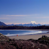 Hiker hiking on Chesterman Beach near Tofino and Pacific Rim National Park Reserve, on West Coast of Vancouver Island, BC, British Columbia, Canada (Model Released)