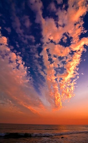 Vibrant clouds hover over the beach along Pacific Coast Highway, Los Angeles