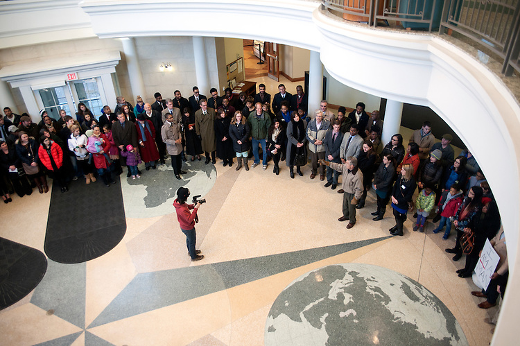 Participants gather inside the fourth floor of Baker University Center on Monday, January 19 as retired Sociology Professor Bruce Ergood leads them in a chorus at the conclusion of a silent march in honor of Dr. Martin Luther King Jr. The march was led by members of the Alpha Phi Alpha fraternity.