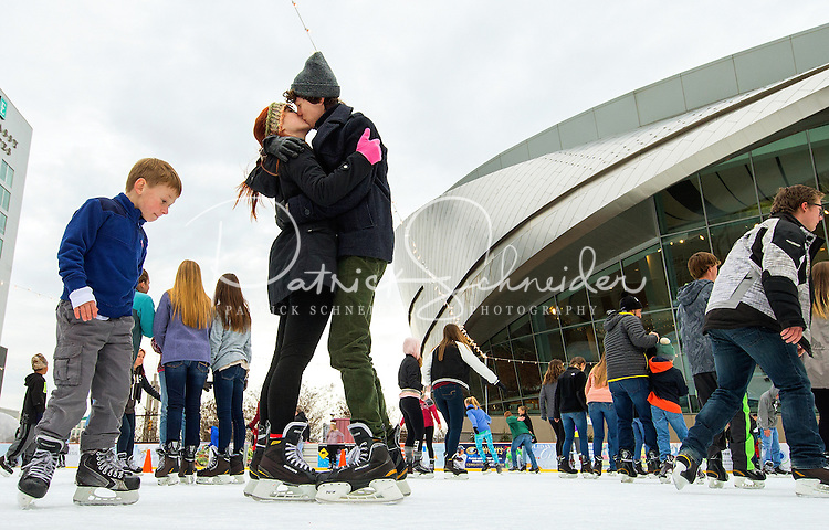 Charlotte Christmas Holiday Photography -  Christmas holiday fun can be found at Holiday on Ice, an outdoor iceskating rink located in uptown Charlotte North Carolina at the NASCAR Hall of Fame Plaza.<br />  <br /> Charlotte Photographer - PatrickSchneiderPhoto.com