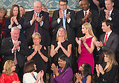Carryn Owens (black dress), the widow of William &quot;Ryan&quot; Owens, a Navy SEAL killed in the Trump administration's first counterterrorism operation in Yemen looks skyward while being acknowledged by U.S. President Donald J. Trump during his address to a joint session of Congress on Capitol Hill in Washington, DC, February 28, 2017. <br /> Credit: Chris Kleponis / CNP