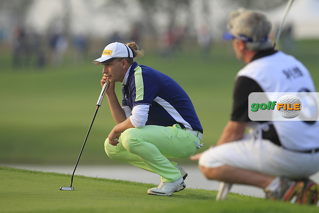Marcel Siem (GER) on the 17th green during Sunday's Final Round of the 2014 BMW Masters held at Lake Malaren, Shanghai, China. 2nd November 2014.<br /> Picture: Eoin Clarke www.golffile.ie
