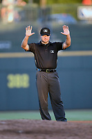 Umpire Colin Baron works a game between the Columbia Fireflies and Lexington Legends on Friday, June 14, 2019, at Segra Park in Columbia, South Carolina. Lexington won, 5-1. (Tom Priddy/Four Seam Images)