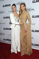 BROOKLYN, NY - NOVEMBER 13: Bella Hadid and Gigi Hadid  at Glamour's 2017 Women Of The Year Awards at the Kings Theater in Brooklyn, New York City on November 13, 2017. <br /> CAP/MPI/JP<br /> &copy;JP/MPI/Capital Pictures