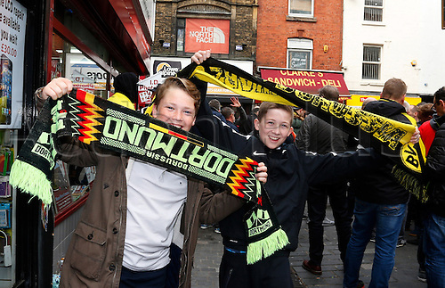 14.04.2016. Liverpool, England.  Two young Borussia Dortmund fans enjoy the atmosphere in Liverpool city centre while they wait for tonight's UEFA Europa League quarter finals soccer match between Liverpool FC and Borussia Dortmund at the Anfield stadium in Liverpool, north west Britain 14 April 2016.
