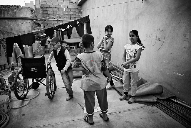 4.4..2015, Kirkuk,Iraq: Asma, Marwa, Marta and Abdullah gathering in the same patio for playing in the afternoons.