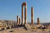 Temple of Hercules, Amman Citadel, Jabal al Qal'a, Amman, Jordan. This Roman temple was built in 162-66 AD and is dedicated to co-emperors Marcus Aurelius & Lucius Verus; view showing base rock, with cityscape of downtown Amman in the background. Picture by Manuel Cohen