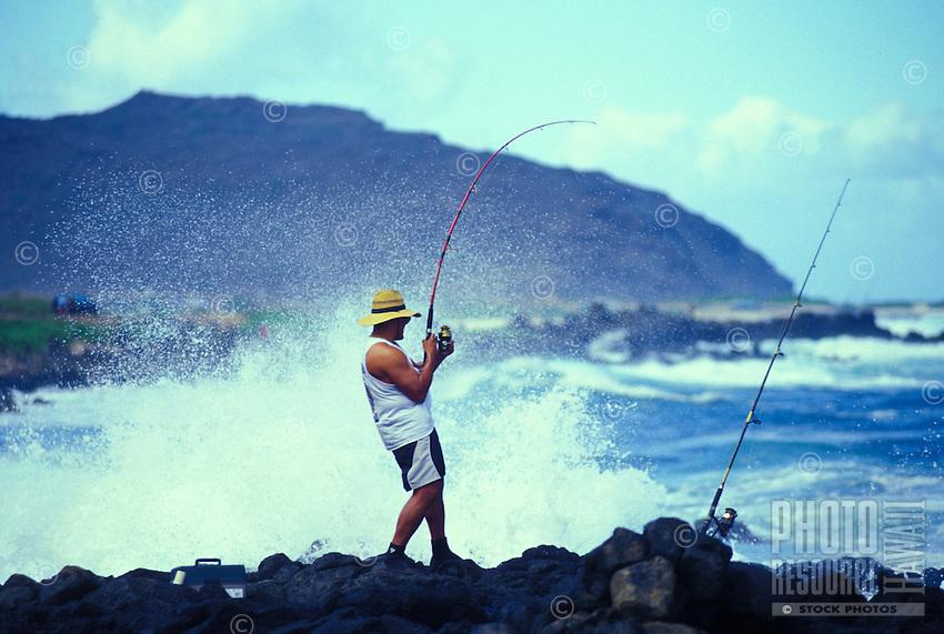 Fisherman pulling in a catch off Sandy Beach,  Kaiwi coastline on Oahu