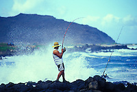 Fisherman pulling in a catch off Sandy Beach,  Kaiwi coastline on Oahu