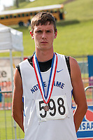 Notre Dame junior Bobby Jansen stands on the awards podium after tying for sixth in the Class 3 high jump, having cleared 6-4 at the 2014 MSHSAA Class 3-4 State Track and Field Championships, Saturday, May 31, in Jefferson City, MO.