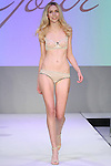 Model walks runway in lingerie from Ajour, during the Lingerie Fashion Night - Romancing The Runway show, by CurvExpo and Lycra on February 23, 2015.