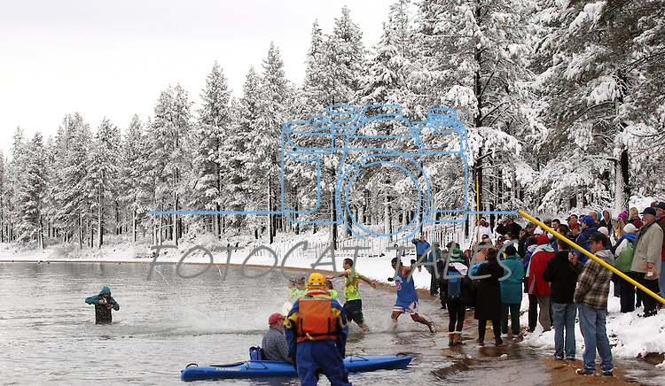 An estimated 500 participants jumped into Lake Tahoe as part of the 8th annual Polar Plunge to benefit Special Olympics at Zephyr Cove, Nev. , on Saturday, March 17, 2012. .Photo by Cathleen Allison