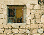 Umm Qais, northwestern Jordan.  Ornate grates secure a window in the museum at Gadara.  © Rick Collier