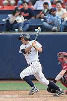 Timmy Richards #13 of the Cal State Fullerton Titans bats against the Washington State Cougars at Goodwin Field on  February 15, 2014 in Fullerton, California. Washington State defeated Fullerton, 9-7. (Larry Goren/Four Seam Images)