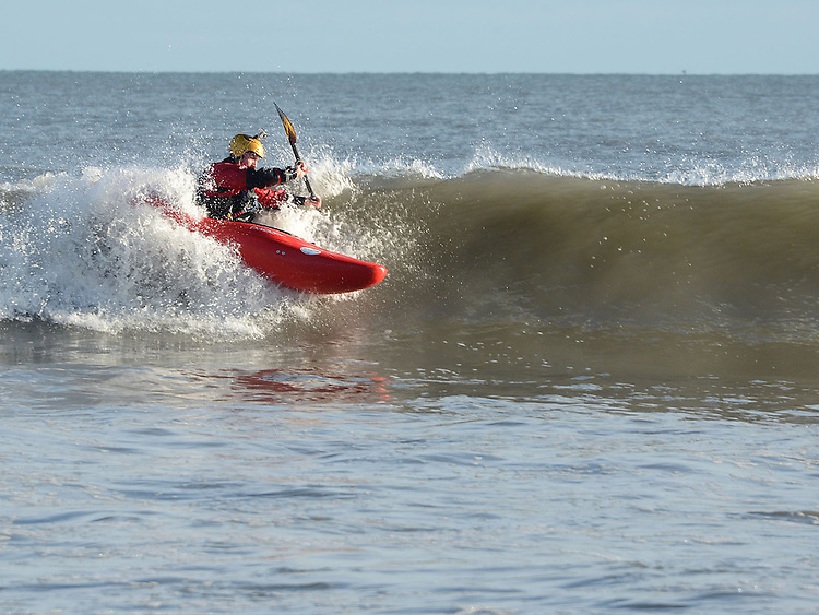 Canoeing on the large waves at high tide at Bettystown beach on Saturday morning. Photo: Colin Bell/pressphotos.ie