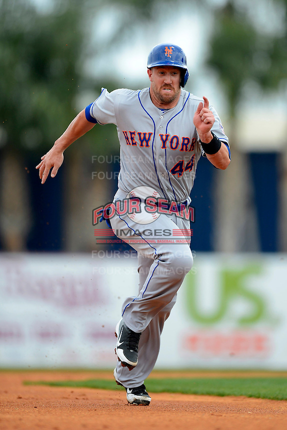 New York Mets catcher John Buck #44 during a Spring Training game against the Detroit Tigers at Joker Marchant Stadium on March 11, 2013 in Lakeland, Florida.  New York defeated Detroit 11-0.  (Mike Janes/Four Seam Images)